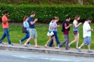 group-of-people-walking-and-texting1